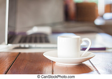 Mini white coffee cup on work station, stock photo