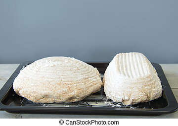Baking bread - rustic rised dough for bread on form