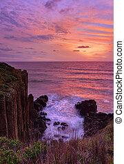 Beautiful sunrise highlights stunning volcanic sea cliffs