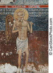 Ancient icon in a Christian temple - a fresco fragment Taken...
