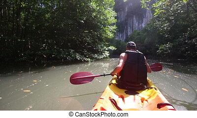 strong elder man rows kayak turns aside and speak - strong...