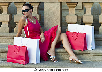Beautiful Latin Woman In Red Dress With Shopping Bags - A...