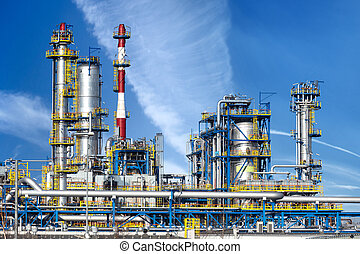 Petrochemical plant, oil refinery factory over blue sky.