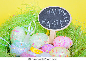 Ester eggs in nest with small chalkboard - Easter eggs in...