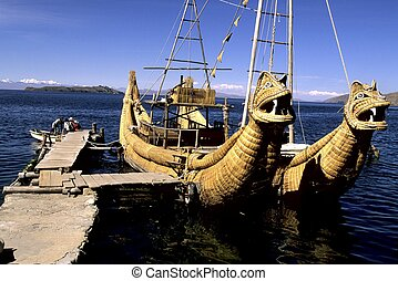 Lake Titicaca- Bolivia - Totora reed boat at shoreline of...