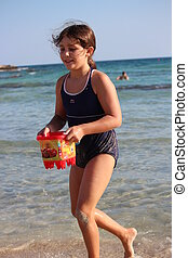 Girl Playing On Beach, Cyprus - Happy, healthy girl playing...