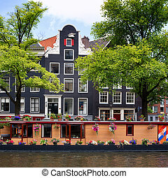 Amsterdam canal with houseboat