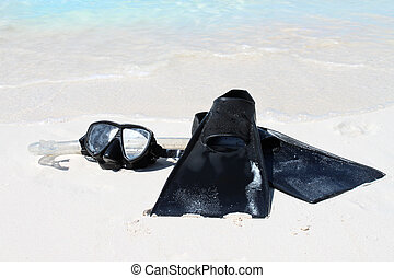 snorkeling equipment - Snorkeling equipment on the sandy...