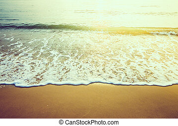 Wave sea water on the beach - vintage effect style and sun...