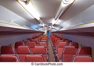 Aircraft cabin of an old airplane - Aircraft cabin with worn...