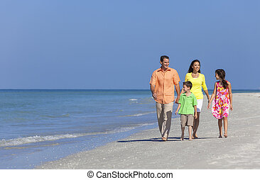 Mother Father and Children Family Walking On Beach