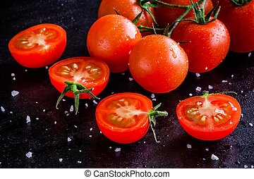 fresh organic cherry tomatoes with drops and sea salt on a...
