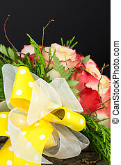 Bright yellow bow with  bouquet