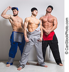 Three sexy man in working overalls - Three sexy muscular man...
