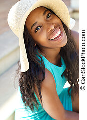 Happy smiling young woman with sun hat