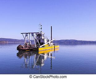 dredging boat - yellow dredging boat on trasimeno lake