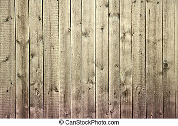 Old dirty wooden fence begun to rot from below background -...