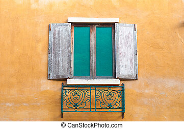 Wooden window on saturate yellow wall house - Background...