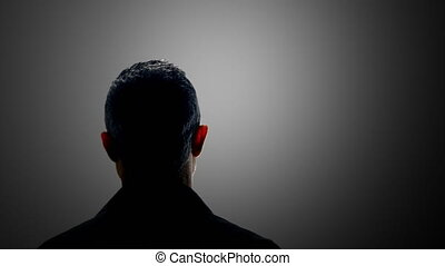 anonymous man interviewed backlit - witness criminal being...