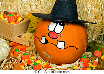 Pumpkin Humor - Funny face on a Halloween pumpkin with corn...