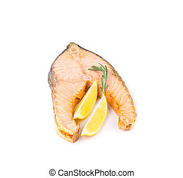 Fried salmon fillet with lemon Isolated on a white...