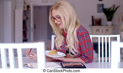 Woman Holding a Plate of Snacks While Reading