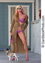 Blond Model Walking Dog - A blond model walks her puppy