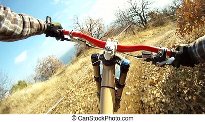 Fast Biking in Mountain - Mountainbiking in forest. Camera...