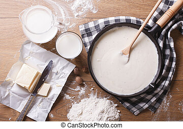bechamel sauce in a pan and ingredients horizontal top view...