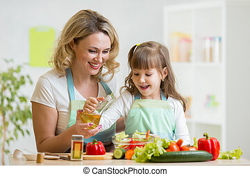 mom and kid preparing healthy food - mom and kid girl...