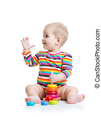 baby girl playing with pyramid toy