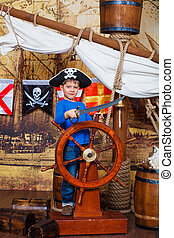 Boy pirate - Cute little boy wearing pirate costume on the...