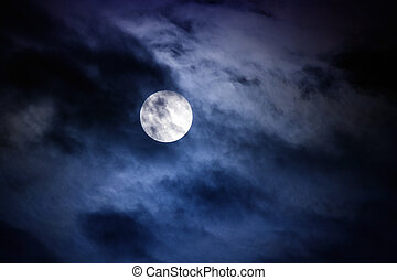 Moon - Midnight - Moon at midnight with clouds covering the...