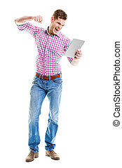 Angry young man punching his tablet pc with his fist - Angry...
