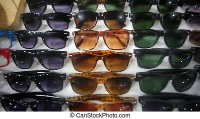 Colorful Sunglasses on sale at the city market. HD....