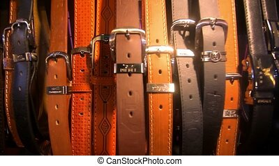 many men's leather belts for sale at flea market. HD. 1920x1080