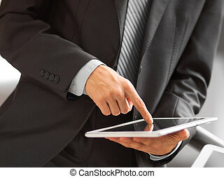 displayed on the tablet screen - Business person analyzing...