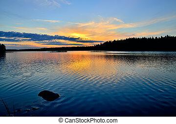 Charm of Karelian sunset. Lake Engozero, Russia