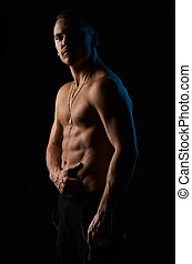 strong sexy man on black background - strong sexy man on a...