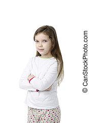 Little girl in nightwear on white