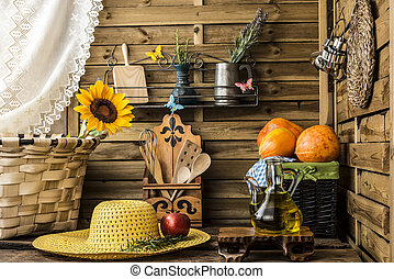 Rustic kitchen with spring environment - Olive oil, pumpkins...