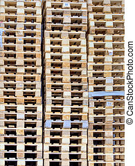 stacked pallets, symbolic photo for freight transport and...