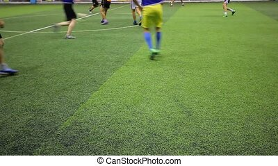 Soccer players on the field view only them legs