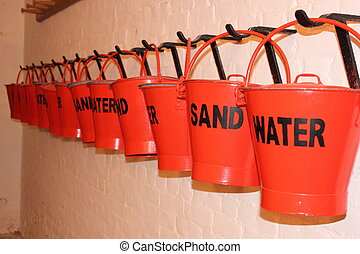 Fire fighting - Painted buckets for fire fighting filled...