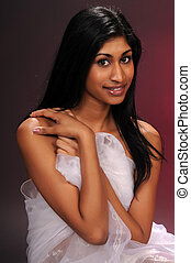 Indian woman - Beautiful young Indian woman draped in sheer...