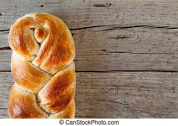 Braided Bread - Closeup of treccia, typical Italian bun,...