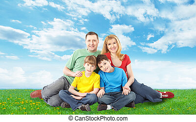 Happy family relaxing in park.