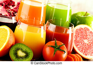 Glasses of fresh organic vegetable and fruit juices Detox...