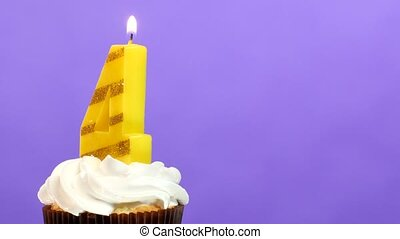 Birthday cupcake with candle number four. - Birthday cupcake...