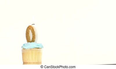 Birthday cupcake with candle number zero. - Birthday cupcake...